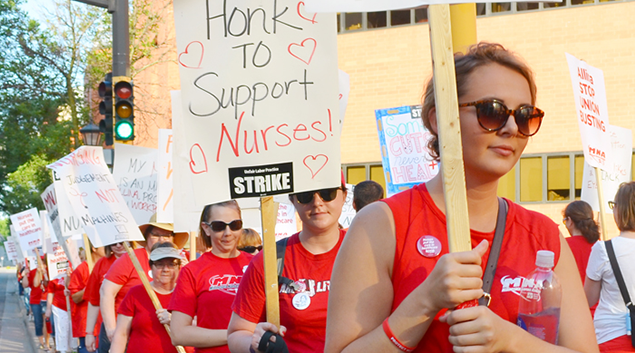 "Photo by <a href=""https://advocate.stpaulunions.org/2016/06/19/photos-picket-lines-go-up-as-5000-allina-nurses-begin-strike/""> Union Advocate </a>"