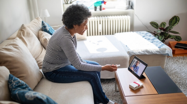 Person attending telehealth appointment on a tablet