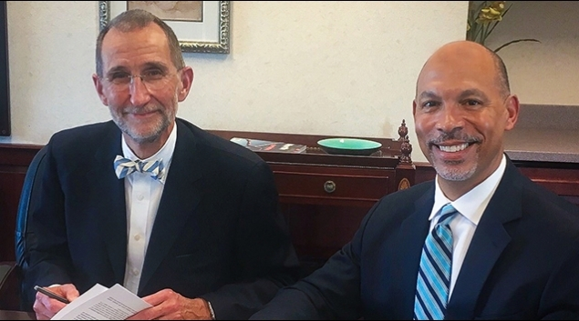 From left, William Roper, MD, with Gene Woods.Photocourtesy of UNH Health Care