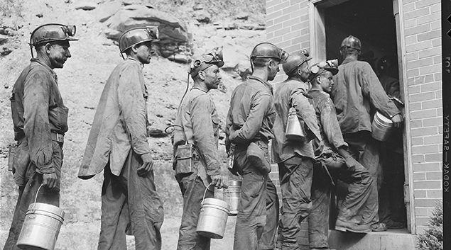 """Photo by <a href= """"https://commons.wikimedia.org/wiki/File:Miners_checking_in_at_the_lamp_house_at_completion_of_morning_shift._Koppers_Coal_Division,_Kopperston_Mines..._-_NARA_-_540920.jpg""""> NARA </a>"""