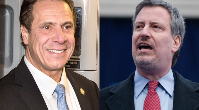 """Credit: <a href=""""https://commons.wikimedia.org/wiki/File:Andrew_Cuomo_2017.jpg"""">Metropolitan Transportation Authority / Patrick Cashin</a> and <a href=""""https://commons.wikimedia.org/wiki/File:Bill_de_Blasio_Inauguration.jpg"""">The office of Public Advocate for the City of New York</a>."""