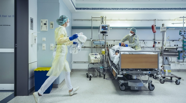 Hospital workers in PPE treating patients
