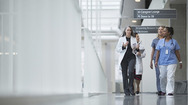 Group of doctors and nurses walking in a hallway