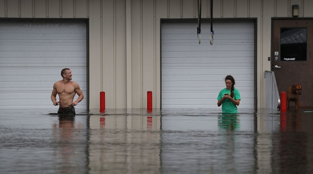 SPRING LAKE, NC - SEPTEMBER 17: Dan Skidmoore (L) and Izeihar Eaton check on their business that is surrounded by the waters from the Little River. Photo: Joe Readle/Getty Images
