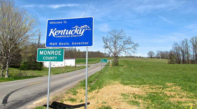 """Credit: <a href=""""https://commons.wikimedia.org/wiki/File:Kentucky-Welcome-Sign-KY87.jpg"""" target=""""_blank"""">Brian Stansberry</a>"""