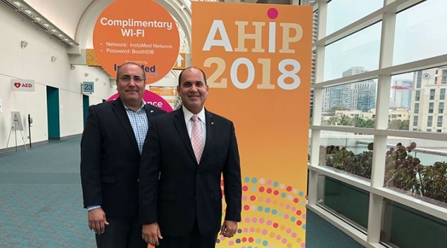 Manny Sanchez, left, COO, and Orlando Gonzalez, president of MMM, a Medicare Advantage and managed Medicaid insurer in Puerto Rico, talk at AHIP about the devastation of Hurricane Maria.