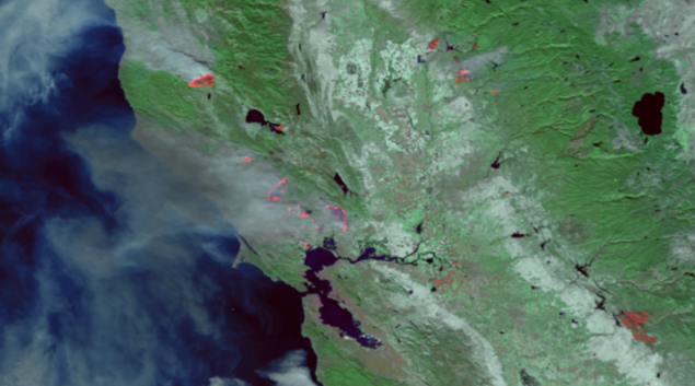 """Satellite image of California wildfires from NOAA of hot spots glowing red from the thermal imagery from Oct. 9. Credit: <a href=""""https://www.nnvl.noaa.gov/MediaDetail2.php?MediaID=2119&MediaTypeID=1"""" target=""""_blank"""">NOAA</a>"""