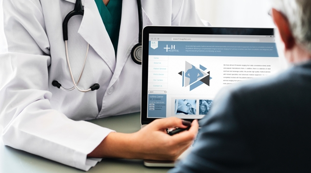 Doctor showing website to person