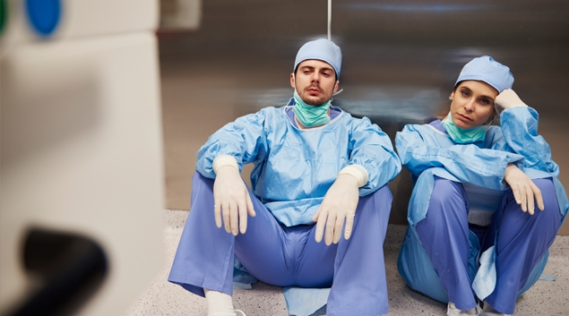 A weary nurse in blue