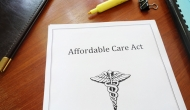 Paper version of the Affordable Care Act on a desk