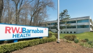 RWJBarnabas sign with building