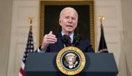 President Biden giving a speech behind a podium