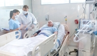 Cardiac patient in hospital bed.