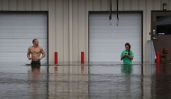People in a flooded storefront.