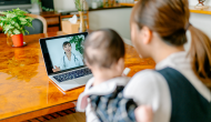 Woman with baby attending telehealth appointment