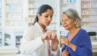 Consumer comparing prices with a pharmacist.