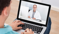 A telehealth visit with a doctor on screen