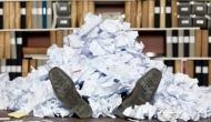 laying on floor buried in paperwork