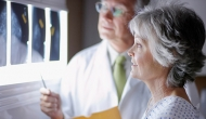 doctor discussing mamogram x-rays with patient
