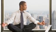 Employee meditating at office