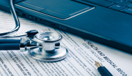 medical record with stethoscope and laptop