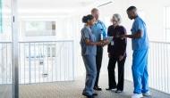 nurses huddling in hallway