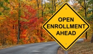 "Road sign with the words ""Open enrollment ahead"""