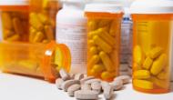 prescription pills spilling from bottle