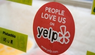"Sticker printed with ""People love us on Yelp"""