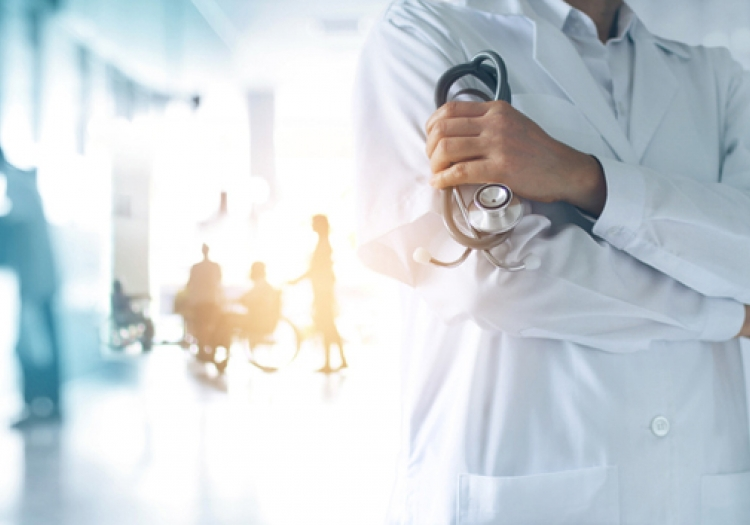 Person holding a stethoscope